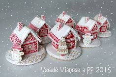AH! Miniature gingerbread houses: look at them in all their red and white detailed glory!