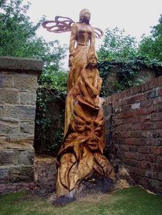 wooden carving in tree stumps | Wood Sculptures of females by artist Thomas Craggs titled: 'Away with ...