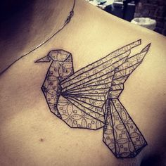 Very unique oragami bird tattoo. Could be an interesting mastectomy scar coverage [p-ink.org]