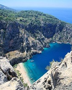 Butterfly Valley, Turkey. Butterfly Valley in Oludeniz, Fethiye is one of the most magical and beautiful bays of Turkey. It is located on the western coast of the Gulf of Belceiz close to Oludeniz and you can get there by boat only.