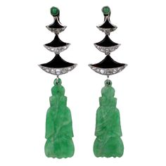 Art Deco Jade Temple Earrings | From a unique collection of vintage dangle earrings at http://www.1stdibs.com/jewelry/earrings/dangle-earrings/