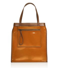 Bag $79.95  DESCRIPTION  Marni. Spacious leather bag (patterned version in straw-look fabric with leather details) with double handles and detachable outer pocket with zip. Leather tab and snap fastener closure. Patterned lining and one inner pocket with zip.  DETAILS  100% leather. -  Imported.  MARNI at H&M