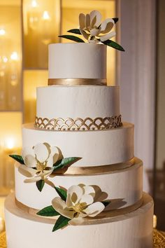 Five tier modern white and gold wedding cake: http://www.stylemepretty.com/2016/09/13/classic-southern-wedding-with-modern-touches/ Photography: Greer Gattuso - http://www.greergphotography.com/