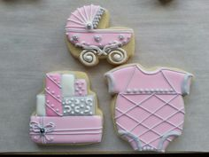 Sugar cookies onesi, baby carriage and shower presents by Baked Ambition.   Pretty in pink.
