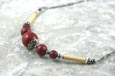 Cranberry red wood, bamboo, and shell necklace with gunmetal black accents and chain by Earthwear Collection
