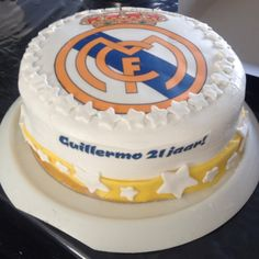 Real Madrid cake filled with buttercream, strawberries and Whipped cream