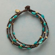 "TWISTED TURQUOISE BRACELET -- Three strands of twisted waxed cotton interweave turquoise nuggets and 14kt gold plated beads. Handcrafted with a coconut wood button clasp. Approx. 7-1/4""L."