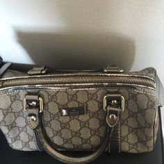 Handbag Beautiful Gucci metallic silver grey leather bag with logos ! Some wear as seen in the pics. Authentic with dust bag.  NO TRADES‼️ Gucci Bags