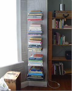 Another invisible bookshelf... but this just uses brackets and doesn't destroy a book.