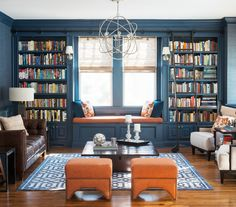 Non-white Built-ins - trim painted same as built ins.  flanking walls look to be tonal grasscloth