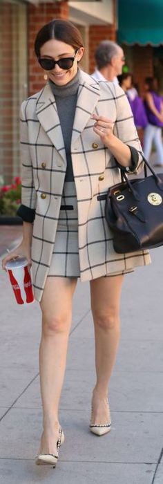Emmy Rossum: coat and skirt – Tory Buch  Purse – Ralph Lauren  Shoes – Paul Andrew