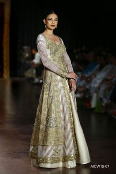 Multi panel ivory-beige tulle jacket featuring delicate gold kasab and tonal resham embroidery paired with a textured silk chanderi skirt.