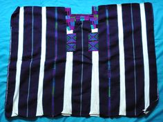 Oxchuc Maya Huipil Mexico | by Teyacapan. This 3 web huipil was woven in the tseltal Maya community of Oxchuc, Chiapas Mexico. The dark stripes are a very dark purple (not black as they may appear in the photo). In the past, most huipiles from Oxchuc were white with red stripes, but this started to change within the past 10 years, with the vertical stripes becoming maroon and now deep purple. Many women still wear white and red huipiles however