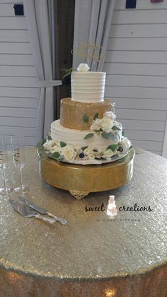 Beautiful classic buttercream cake with a gold sequin tier. Finished with fresh flowers.  Cream cheese pound cake with vanilla buttercream and red velvet cake with vanilla buttercream. #sweetcreationsbycandi
