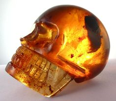 Super clear, beautiful AAA graded amber skull from the mines in Chiapas Mexico near San Cristobal.  2.22 ounces, about 2 inches long.
