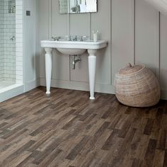 this vinyl plank flooring reveals the true beauty of wood through highlighted detailing and wood grain