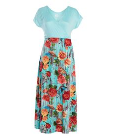 This floor-sweeping maxi dress flaunts a flattering surplice neckline and fresh floral print for a hint of charming appeal.Size 1X: 58'' long from high point of shoulder to hemKnit95% polyester / 5% spandexMachine wash; tumble dryMade in the USA