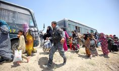 Iraqi forces help families near al-Sejar village, in Iraq's Anbar province, after fleeing the city of Falluja during a major operation by pro-government forces to retake the city from Islamic State.