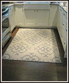 outdoor rug in kitchen (walmart) - love this. Maybe under the table?