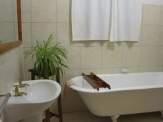 Accommodation in Graaff-Reinet at Camdeboo Cottages - all cottages & rooms are en-suite. Old Fashioned Cast-iron baths available upon request Camdeboo Cottages