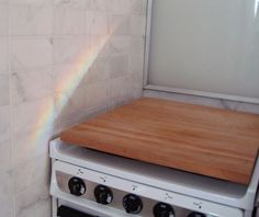 A large cutting board provides extra workspace when the cooktop is not in use. Also works over the sink