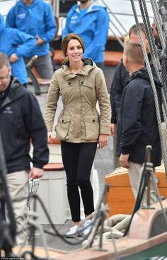 Kate wore a £350 wax parka jacket by British brand Troy London, with white plimsoles while...