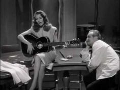 "Rita Hayworth (dubbed by Anita Ellis) sings ""Put The Blame On Mame""  - in the 1946 movie ""Gilda"". Also starring Glenn Ford."