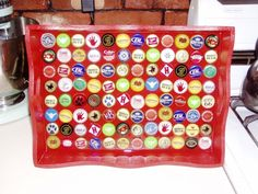 Bottle CapTray, an unfinished wood tray at a craft store and painted it red- Then, I lined it with assorted beer bottle caps and covered the caps with resin.  It works perfectly!  I plan to use this technique again, perhaps to make end tables or just wall art.  I love the bright colors and variety in the bottle caps., Home Decor Project Beer Cap Crafts, Cork Crafts, Craft Beer, Diy Crafts, Bottle Cap Projects, Bottle Cap Crafts, Beer Bottle Caps, Bottle Top, Phi Mu Crafts