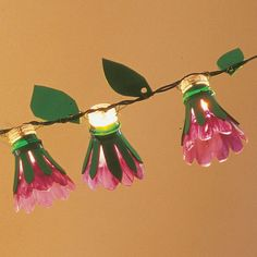 fun flower lights from plastic bottles.. recycling & cute!
