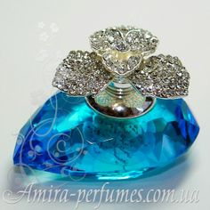 beautiful perfume bottle .......Stunning in color and love the bling on top. WOW. B.