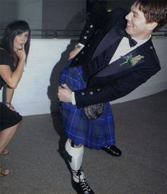 John Barrowman at his wedding, showing off for Eve Myles