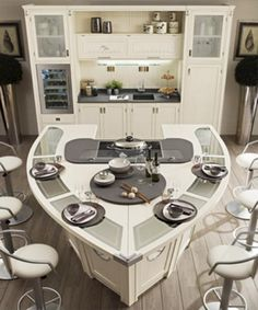 modern kitchens with wood and leather furniture for dining areas-quite unusual counter shape...but it's nice