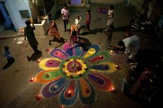 "Members of the Pakistani Hindu community stand around a ""rangoli"