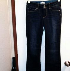 "Paige Super Mckinley Jeans Sz 28 Paige Hidden Hills Super McKinley Boot cut low rise jeans.  Sz. 28. Dark wash. Cotton & poly blend. 5 pockets. Zipper fly. Two button closure. Waist 29"". Rise 8.5"". Inseam 34"". Great used cond.  Not a smoke free home. Paige Jeans Jeans Boot Cut"