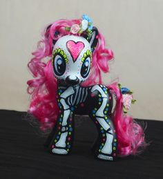 My little pony repaint I just finished for my nieces birthday. I found this at Goodwill and repainted it with Day of the dead make up and I redid the hair.