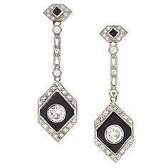 Art Deco Onyx Diamond Platinum Earrings | From a unique collection of vintage dangle earrings at https://www.1stdibs.com/jewelry/earrings/dangle-earrings/