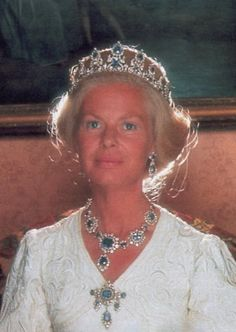 The Duchess of Kent wearing the Cambridge Sapphire Parure, United Kingdom (from top, Tiara, Earrings, Necklace, Brooch; sapphires, diamonds). The tiara is shown here in it's original form. The Duchess had a second tiara made by taking the largest sapphire and diamond clusters from the long necklace and forming a button tiara set on a velvet band. Unfortunately, the Kents decided to sell parts of the parure for financial reasons. They sold this tiara (in a diamond prong design with sapphires ...