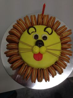 My nephews birthday cake #LionCake with macarons for the mane #JungleParty #TheLionKing