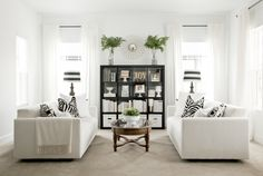 Black and White Living Room - I would add a patterned rug between the sofas, and probably a bit more color/texture in the pillows, but I love this!