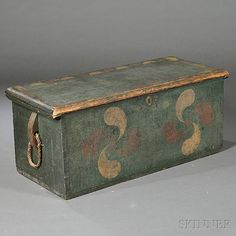 Paint-decorated Sea Chest, New England, late 18th century, the dovetail-constructed box painted blue green, the top with diamond scratch panel bordered by red and white demilunes, the front with two pink and red pinwheels, (imperfections), ht. 15, wd. 34, dp. 15 1/2 in.
