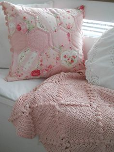 I love the crochet edging on this pillow.  I also love the battenburg lace pillow and afghan in the picture.  Nice grouping.
