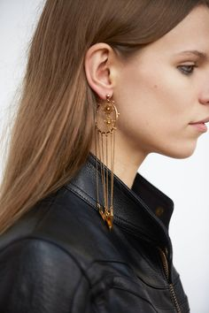 Chloe Fall 2016 - Fine charm earrings brush the shoulder, gently coming through the hair