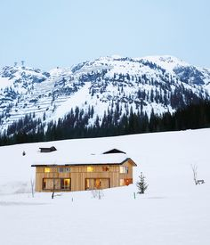 The Strolz House nestles in the winter snow at the edge of the Austrian village of Lech. Large wooden shutters help protect the windows against avalanche damage.  Photo by Richard Powers.