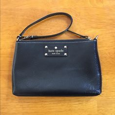 Kate Spade Black Large Wristlet Very simple Wristlet from Kate spade. Got two Christmases ago, rarely use this. The outside looks great and the inside is pristine. The strap can be worn two ways, goes with anything! Make me an offer :) kate spade Bags Clutches & Wristlets