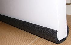 Make a cheap door draft stopper with pipe  foam insulation..under $1.00!!!