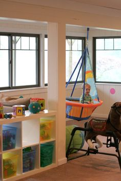 AHHHH! This is the coolest play room ever! I want mine to be this cool - only with more black, red and MONSTERS! :)