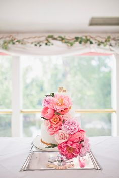 Wedding cake decorated in pastel pink flowers | Photography by http://sarahjaneethan.co.uk/ & http://www.mattethan.co.uk/