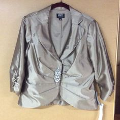 Adrianna Papell aft 5 NWT!! Adrianna Papell after 5 jacket NWT! Taupe color. There is a slight marking on the right side as you'll see in the 2nd picture. It's barely noticeable. Beautiful after 5 jacket! Adrianna Papell Jackets & Coats