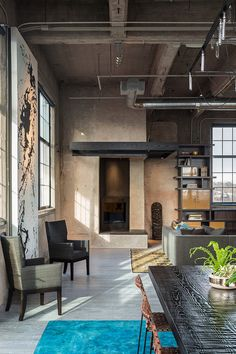 Historic flour mill converted to industrial style loft in Denver by Robb Studio
