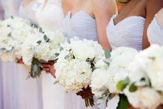 Sweetgrass Social wedding at Alhambra Hall. Erika & Sergio. Light purple bridesmaids dresses with white bouquets of hydrangeas.